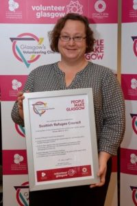 Gün from Scottish Refugee Council receives the Volunteering Charter Mark certificate