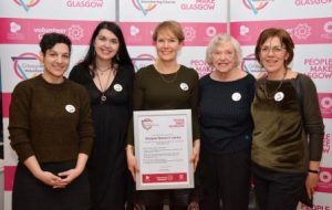 photo-of-Glasgow-Womens-Library-team-collecting-their-Volunteering-Charter-Mark-certificate