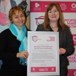 photo of Fiona Moss and Bernadette Monaghan with HSCP Charter Mark certificate February 2018