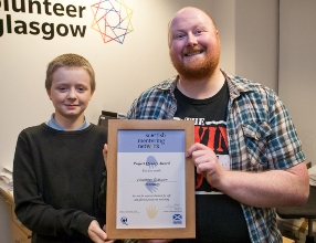 photo of J and G with intandem's Project Quality Award from Scottish Mentoring Network